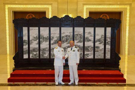 Commander of the Chinese navy, Admiral Wu Shengli (R) shakes hands with U.S. Chief of Naval Operations Admiral John Richardson during a welcome ceremony held at the Chinese Navy Headquarters in Beijing, China, July 18, 2016. REUTERS/Ng Han Guan/Pool