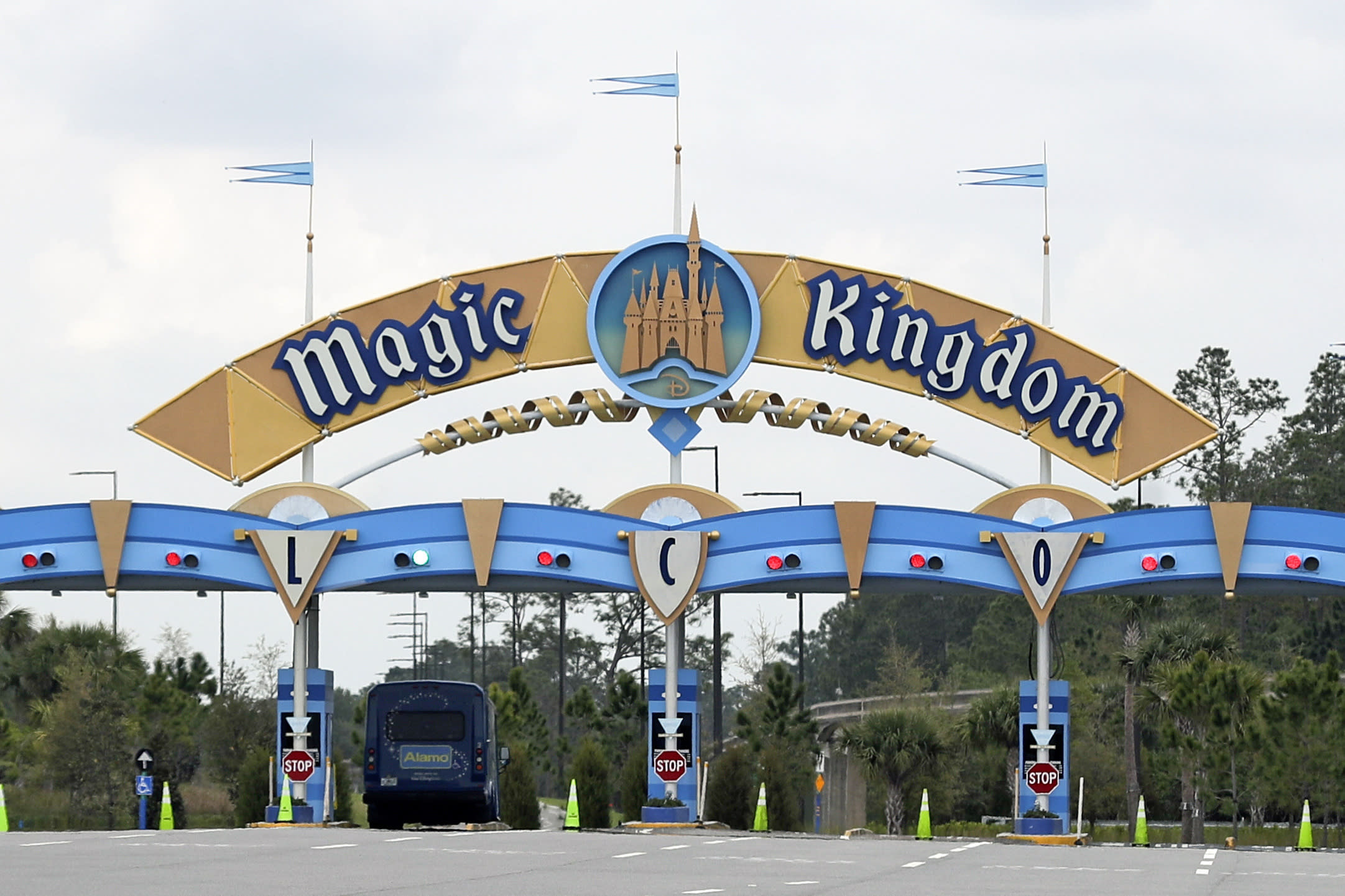 """FILE - In this March 16, 2020, file photo, the entrance to the parking lot at the Magic Kingdom at Walt Disney World is closed in Lake Buena Vista, Fla. The Splash Mountain ride at Disney parks in California and Florida is being recast. Disney officials said the ride would no longer be tied to the 1946 movie, """"Song of the South,"""" which many view as racist. Instead, the revamped ride will be inspired by the 2009 Disney film, """"The Princess and the Frog,"""" which has an African-American female lead. (AP Photo/John Raoux, File)"""