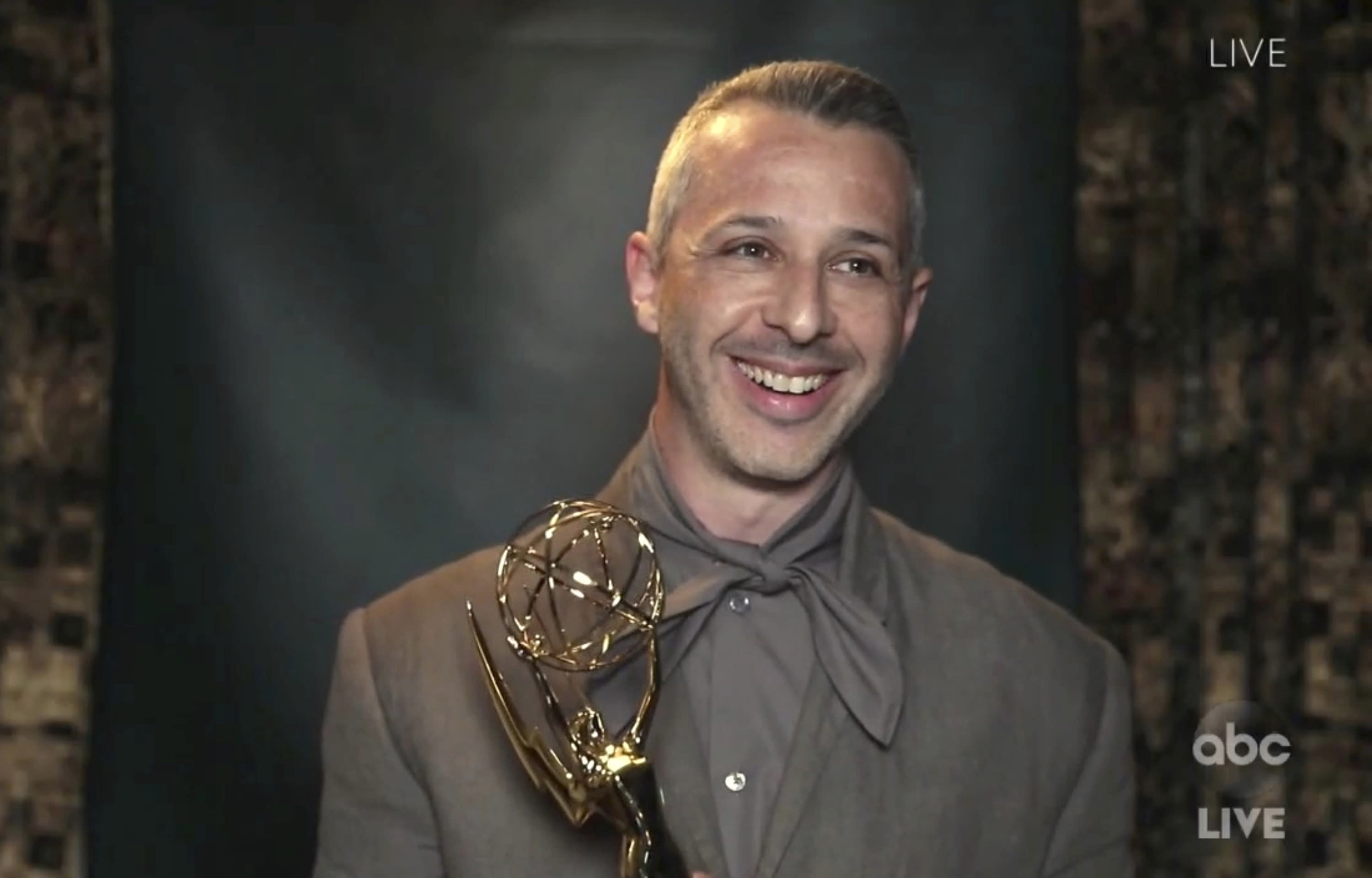 """In this video grab captured on Sept. 20, 2020, courtesy of the Academy of Television Arts & Sciences and ABC Entertainment, Jeremy Strong accepts the award for outstanding lead actor in a drama series for """"Succession"""" during the 72nd Emmy Awards broadcast. (The Television Academy and ABC Entertainment via AP)"""