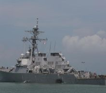US Navy crash: Divers recover remains of missing sailors