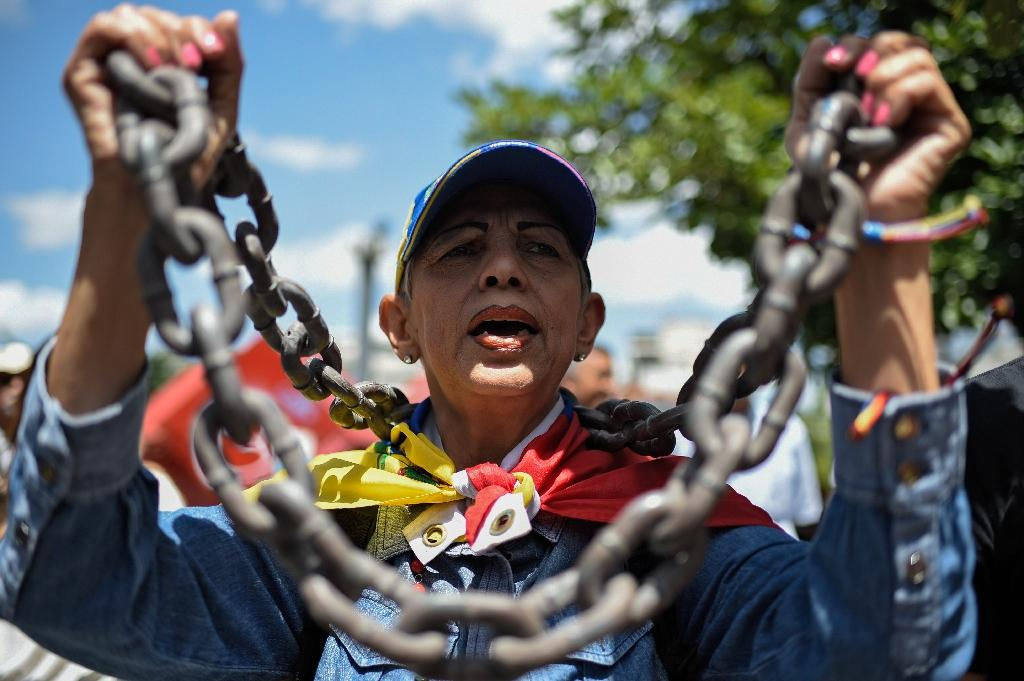 Ten people have been arrested over the alleged drone attack, including a Venezuelan opposition lawmaker whose arrested has sparked demonstrations in Caracas (AFP Photo/Federico PARRA)