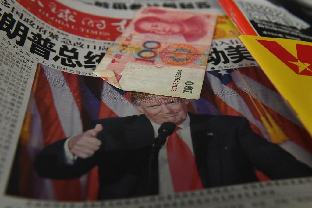 US President-elect Donald Trump is accusing China of currency manipulation and flexing its military might in the South China Sea
