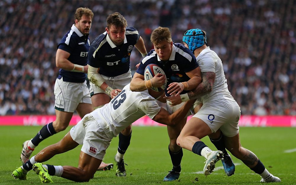 Huw Jones breaching the England defence - 2017 Getty Images