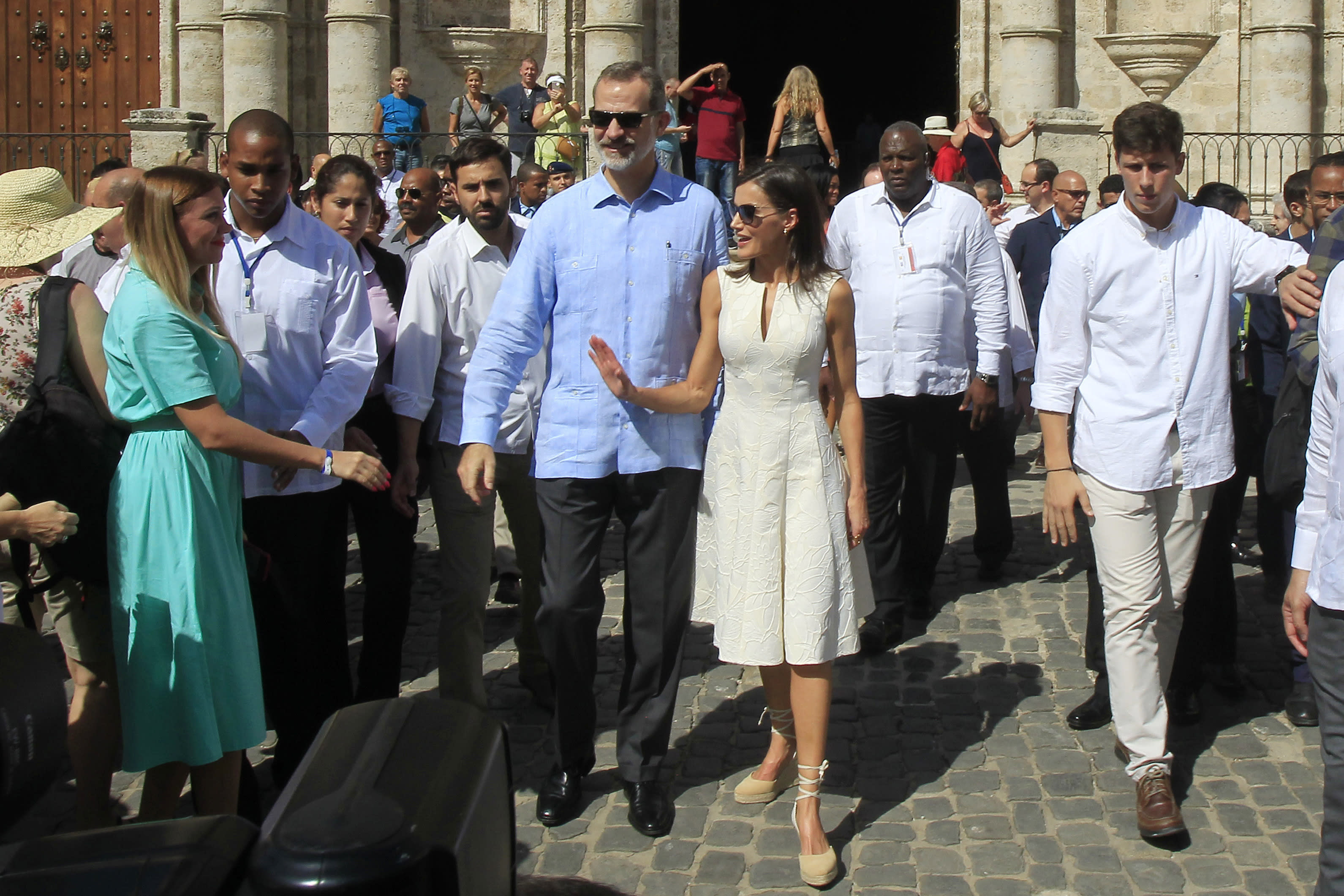 Spain's King Felipe VI and Queen Letizia walk in Old Havana, Cuba, Tuesday, Nov. 12, 2019. (Jorge Luis Baños/Pool Photo via AP)