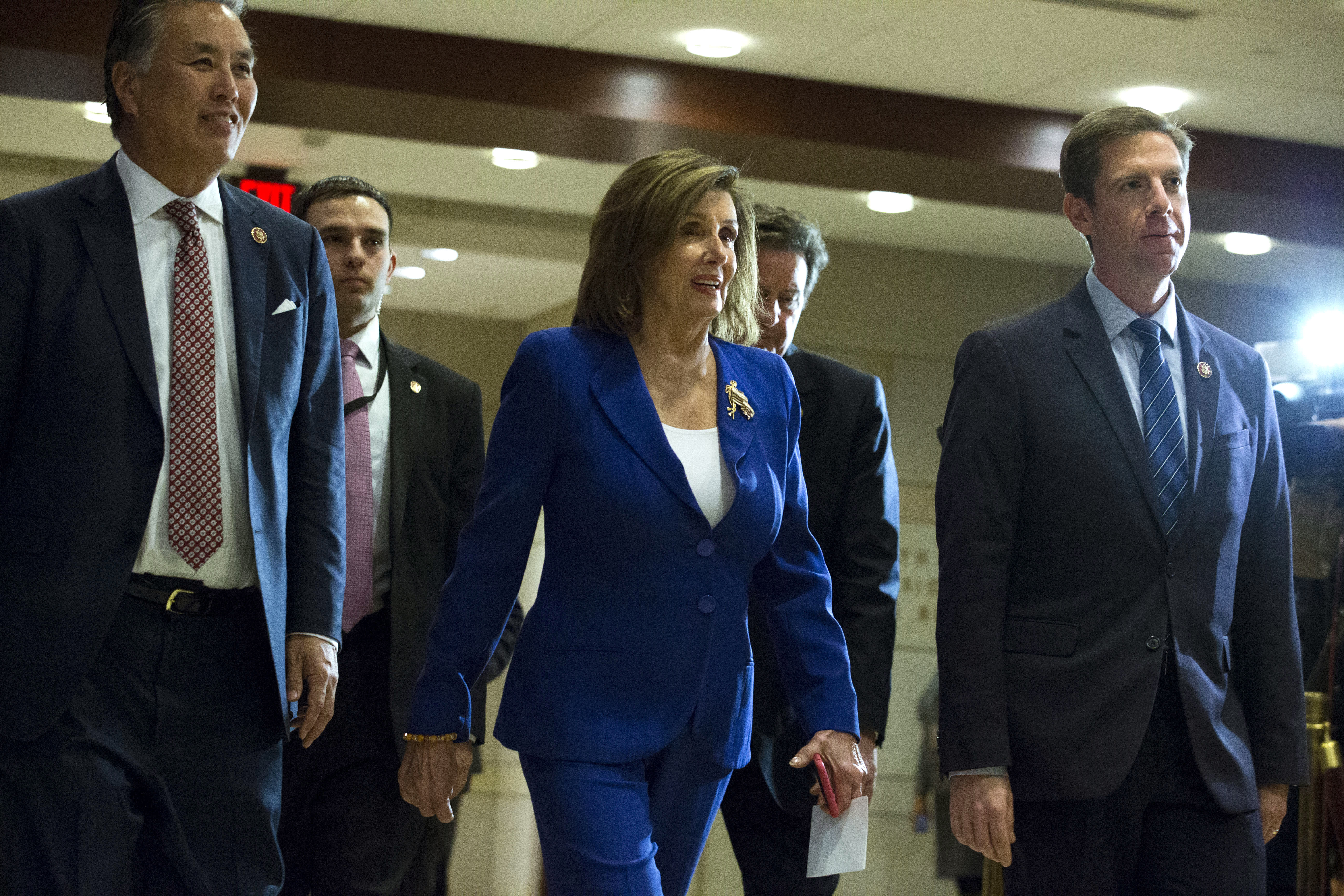 Speaker of the House Nancy Pelosi, D-Calif., accompanied by members of the Congress arrive for a briefing on last week's targeted killing of Iran's senior military commander Gen. Qassem Soleimani on Capitol Hill, in Washington, Wednesday, Jan. 8, 2020. (AP Photo/Jose Luis Magana)