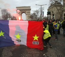 'Yellow Jacket' protests paralyze Paris and threaten Macron's government