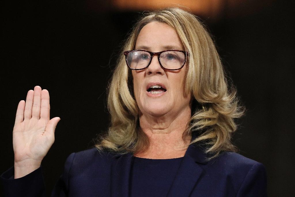 A sexual assault hotline is reporting a surge in calls following the Senate testimony of Christine Blasey Ford, who accused Supreme Court nominee Brett Kavanaugh of sexually assaulting her decades ago (AFP Photo/JIM BOURG)