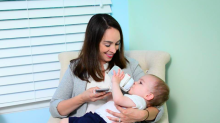 Dad invents gadget that allows parents to feed their baby and scroll their smartphone at the same time