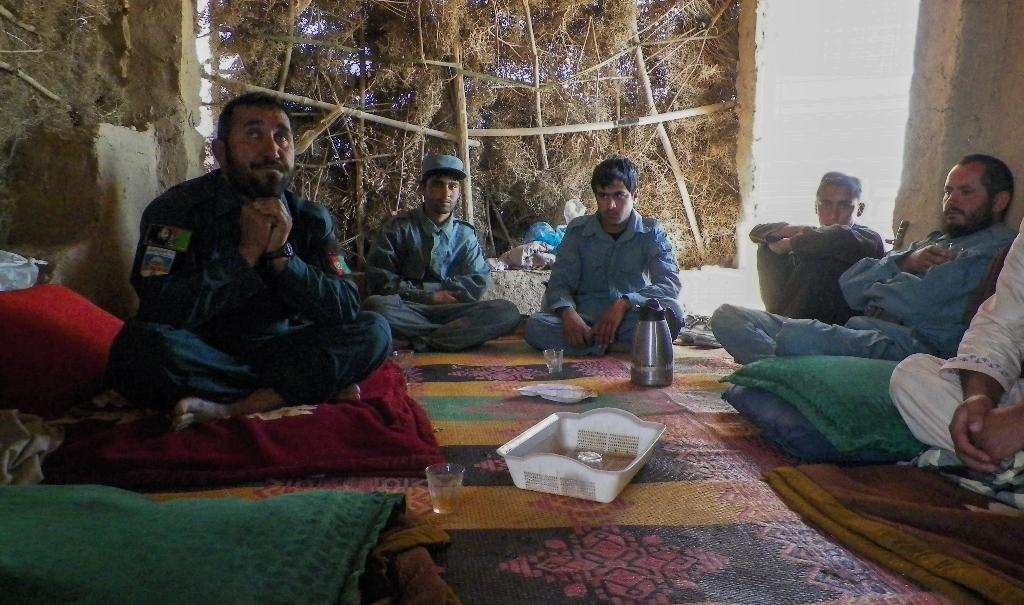 Afghan police commander Seddiqullah, 30, (L), in this April 28, 2016 interview with AFP, voices concern about the Taliban's use of child sex slaves to mount insider attacks on police in southern Afghanistan (AFP Photo/RATEB NOORI)