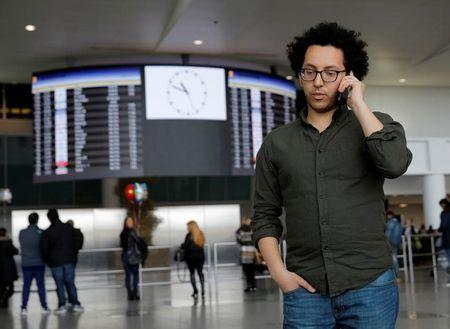Mark Doss, Supervising Attorney for the International Refugee Assistance Project at the Urban Justice Center speaks on his cell phone at John F. Kennedy International Airport in Queens, New York, U.S.