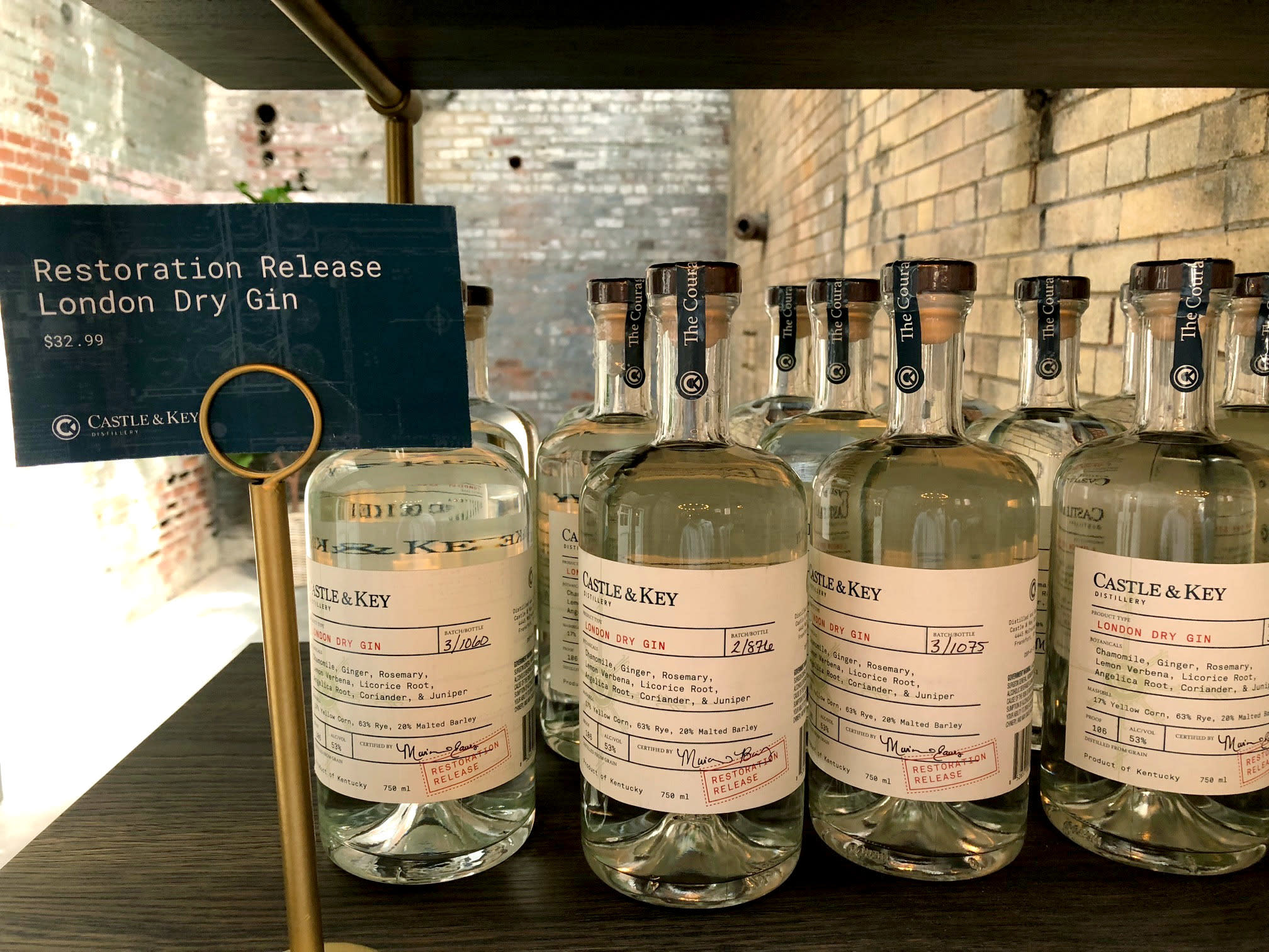 In this Friday, Sept. 14, 2018 photo, bottles of gin produced at Castle & Key Distillery are displayed for sale at the distillery's gift shop in Millville, Ky. Spirits production resumed at the famed distilling site in late 2016, but the new brand's bourbon won't reach consumers until around 2021. (AP Photo/Bruce Schreiner)