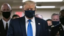 As virus rages in US, Trump finally wears a mask