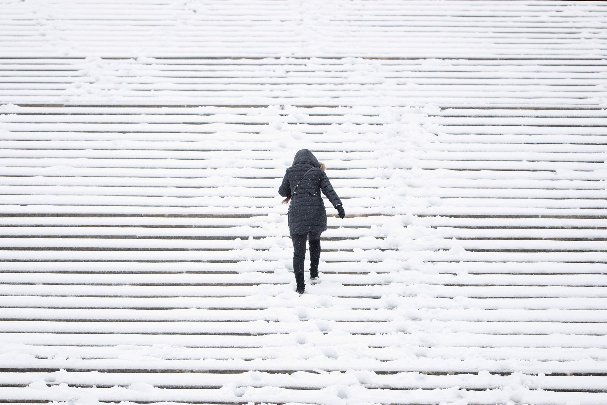 <p>A woman climbs the snow covered steps of the Philadelphia Museum of Art during a winter storm in Philadelphia, Tuesday, March 14, 2017. (AP Photo/Matt Rourke) </p>