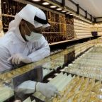 Gold dips to two-week low on recovery hopes