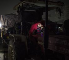 AP PHOTOS: Angry Indian farmers besiege capital in trucks