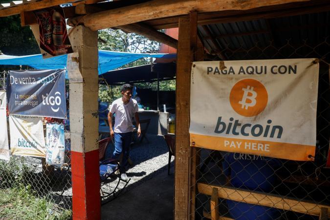 Bitcoin banners are seen outside of a small restaurant at El Zonte Beach in Chiltiupan, El Salvador June 8, 2021. REUTERS/Jose Cabezas