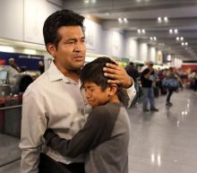 Donald Trump's immigration crackdown encapsulated in poignant images of father being deported