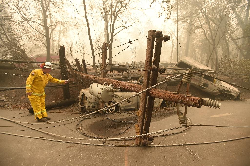 PG&E faces potentially huge liabilities for its role in causing the 2018 California wildfires, as in this November 2018 photo (AFP Photo/Josh Edelson)
