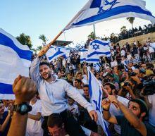 Photos: Israeli ultranationalists march through East Jerusalem, stirring animosity