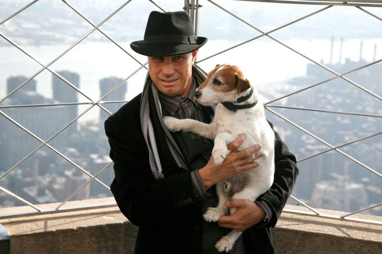 Dog trainer Omar von Muller and Uggie up the Empire State building in New York. The talented dog 'was a family member' he says. (AFP Photo/Andy Kropa)