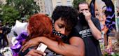 People react after a decision in the criminal case against police officers involved in the death of Breonna Taylor. (Reuters)