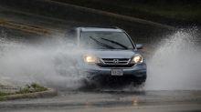 The Latest: Sally speeding up, still dumping heavy rain