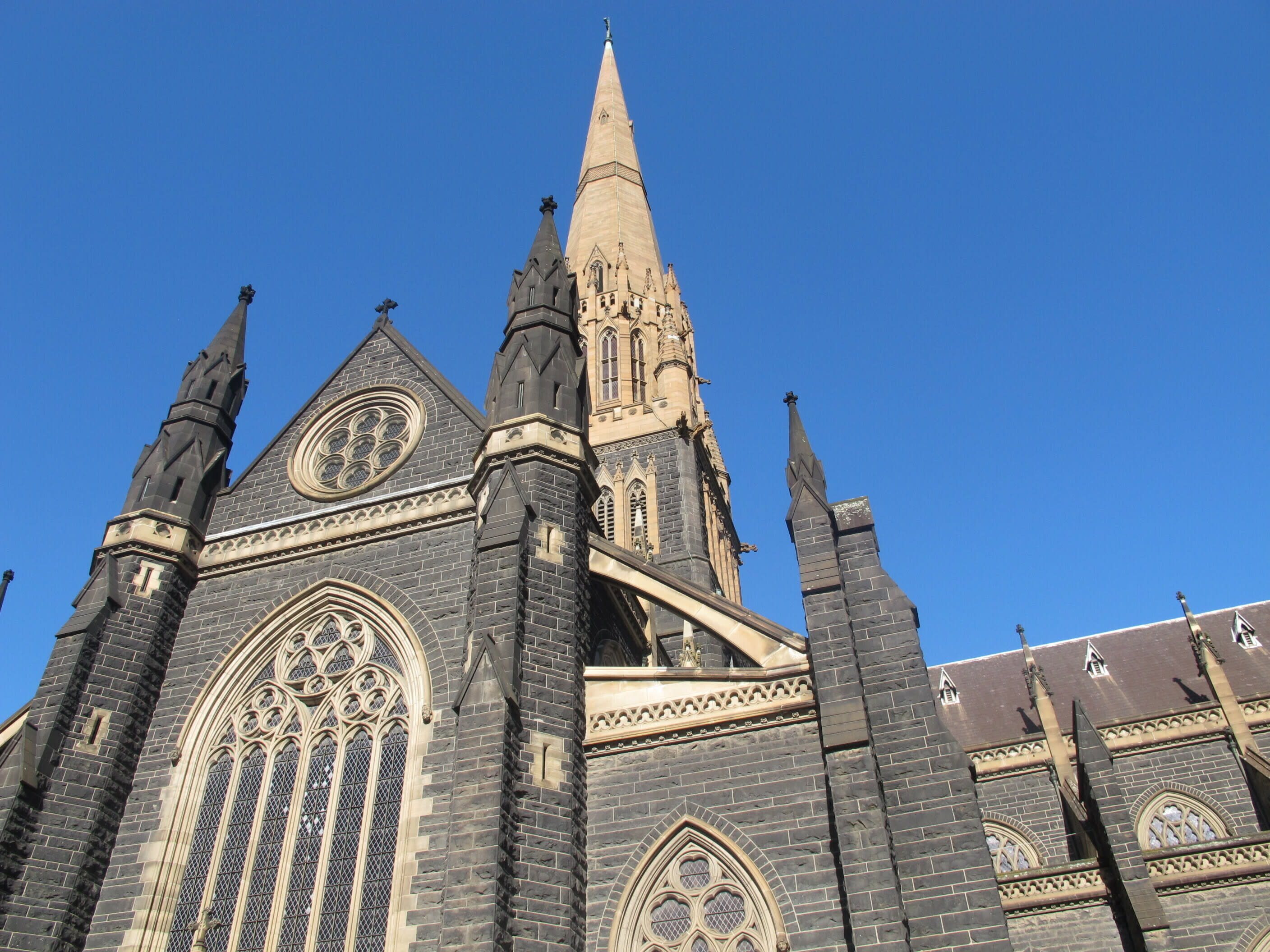 FILE - This Sept. 9, 2018, file photo shows the facade of St. Patrick's Cathedral in Melbourne. Cardinal George Pell's appeal against his convictions for child molestation was largely a question of who the jury should have believed, his accuser or a senior priest whose church role was likened to Pell's bodyguard. Pell's accuser was a 13-year-old choirboy when he alleged that he was abused by then-Melbourne Archbishop Pell at the city's St. Patrick's Cathedral in December 1996 and February 1997. (AP Photo/Rod McGuirk, File)