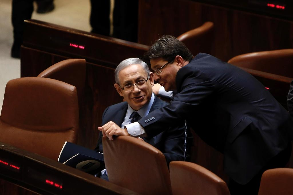 Likud Knesset member Ofir Akunis (R) talks with Israeli Prime Minister Benjamin Netanyahu (L) during a meeting at the parliament in Jerusalem on May 13, 2015