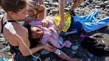 In pictures: Sunbathers help boat of migrants after they wash up on  Canary Islands