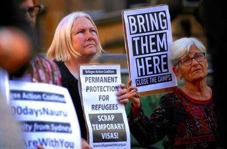 FILE PHOTO: Refugee advocates hold placards and banners during a protest in central Sydney, Australia, October 5, 2016 calling for the closure of the Australian detention centres in Nauru and Manus Island. Picture taken October 5, 2016. REUTERS/David Gray