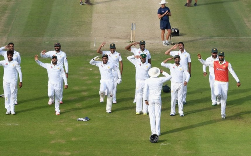Pakistan's team salute Younis Khan in celebration of winning the first Test against Pakistan last summer - 2016 Getty Images