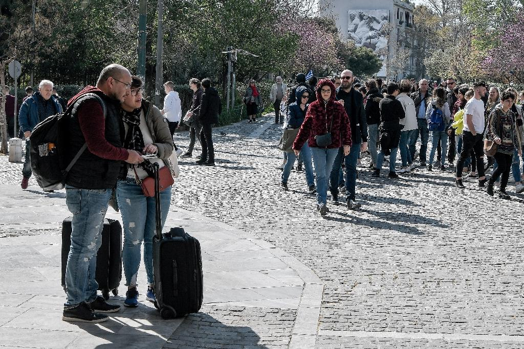 Noise, debris, bins and rolling luggage -- that's how some locals see the Airbnb takeover (AFP Photo/LOUISA GOULIAMAKI)