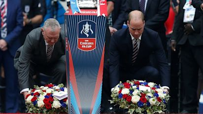 Prince William lays a wreath to Manchester victims amid unprecedented FA Cup final security