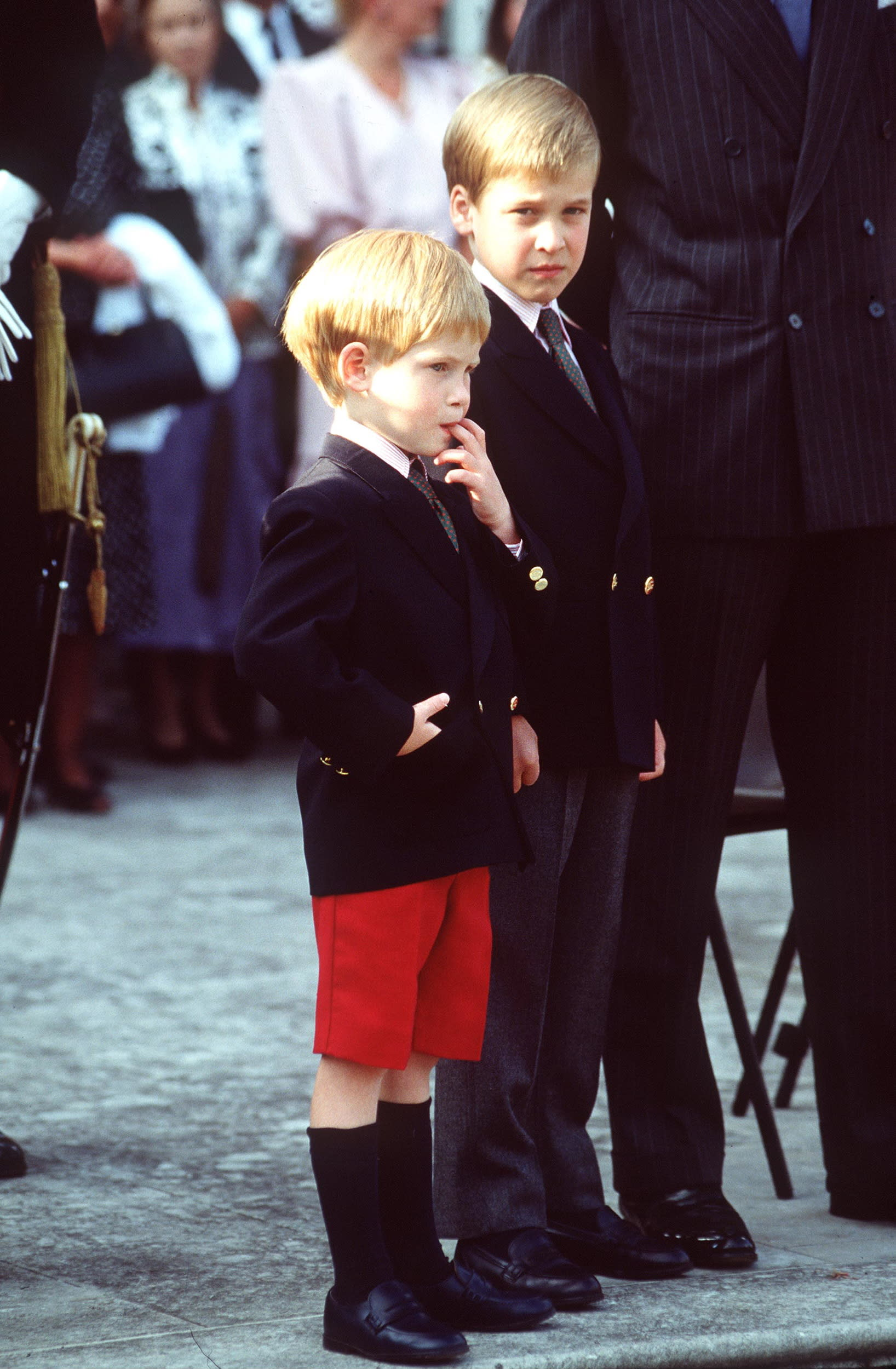 LONDON, UNITED KINGDOM - JUNE 29:  Shy Prince Harry With His Finger In His Mouth Stands With His Brotehr Prince William At Their First Official Event - Beating The  Retreat Parade At Kensington Palace.  (Photo by Tim Graham/Getty Images)