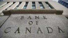 Bank of Canada sees rates unchanged until 2023, shifts bond buying to longer maturities