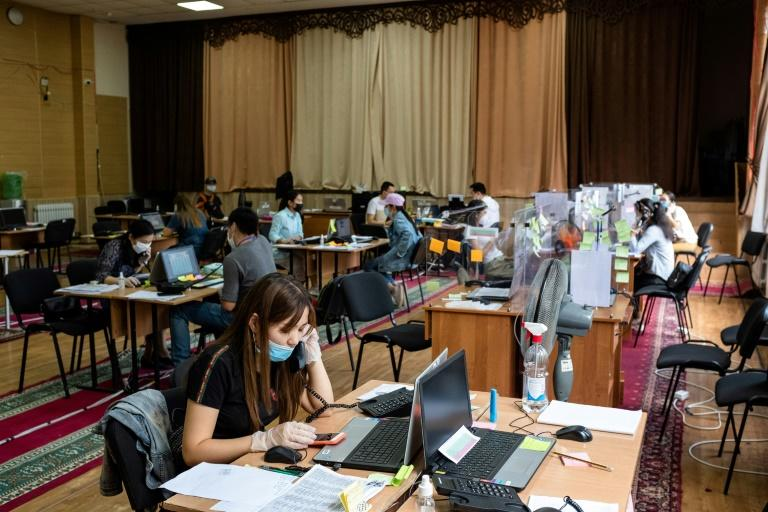 A team of more than 60 medics and medical students are now fielding at least 3,000 calls per week at a call centre in Bishkek (AFP Photo/DANIL USMANOV)
