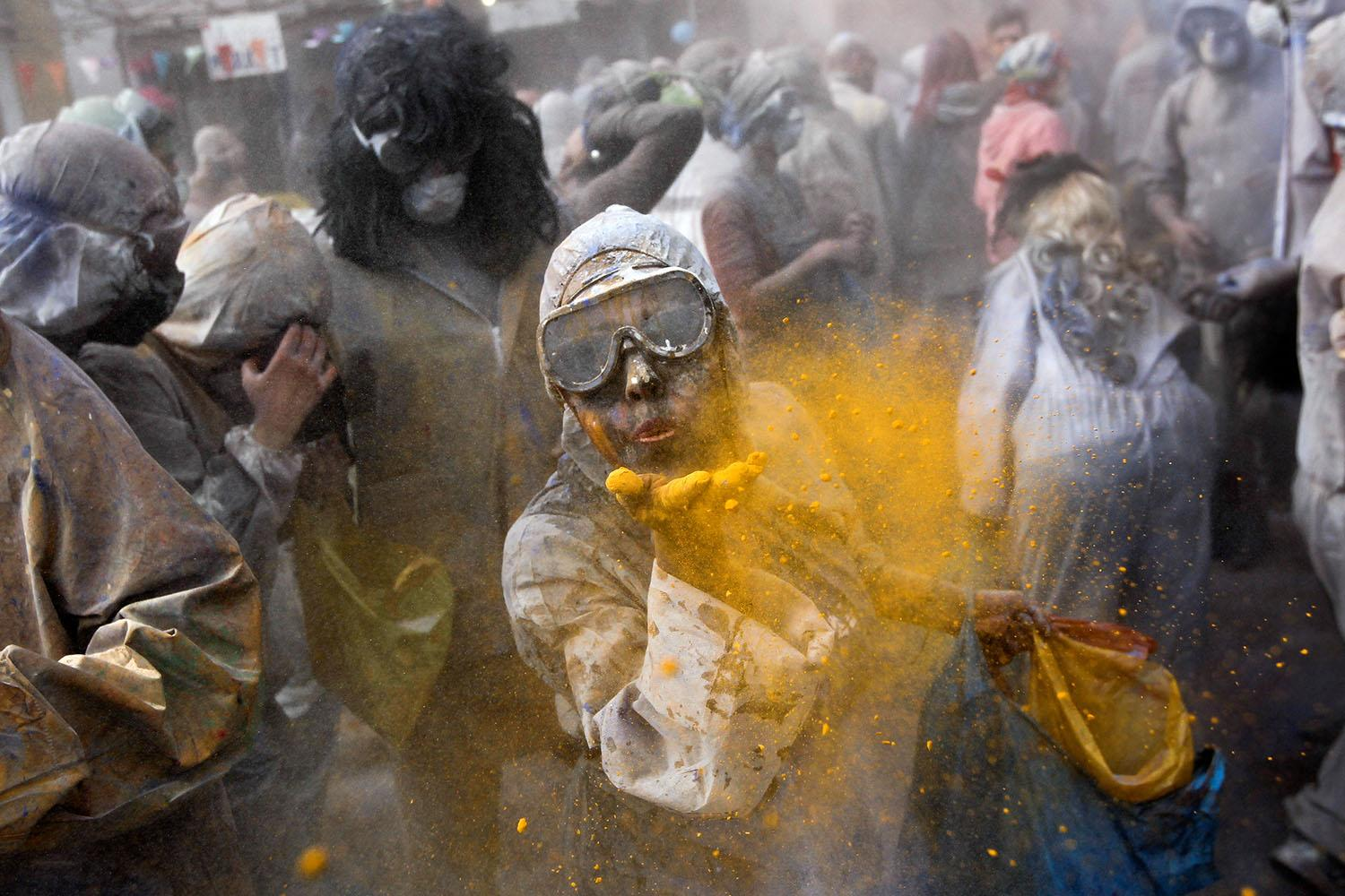 <p>Revelers throw colored flour at each other to celebrate Clean Monday, also known as Ash Monday, in the port town of Galaxidi, Greece, Feb. 27, 2017. Clean Monday is a traditional festivity marking the end of the carnival season and the start of the 40-day Lent period until the Orthodox Easter. (Photo: Alkis Konstantinidis/Reuters) </p>