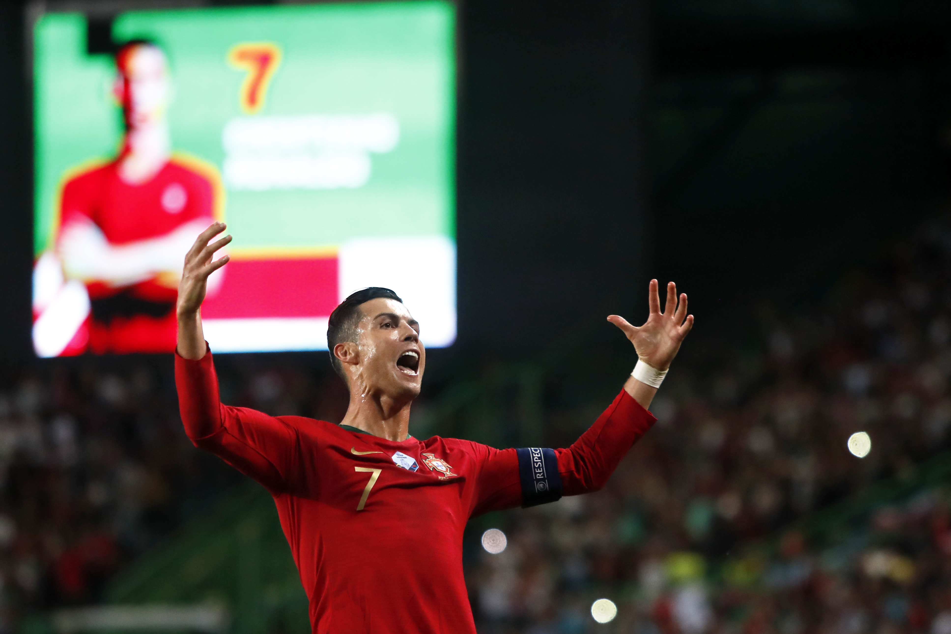 Portugal's Cristiano Ronaldo celebrates after scoring his side's second goal during a Euro 2020 group B qualifying soccer match between Portugal and Luxembourg at the Jose Alvalade stadium in Lisbon, Friday, Oct 11, 2019. (AP Photo/Armando Franca)