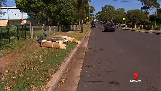 Body left with rubbish on roadside