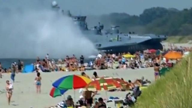 Russian beach-goers surprised by massive hovercraft