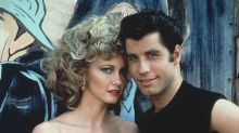 The new owner of  Olivia Newton-John's 'Grease' jacket gave it back to her in a sweet moment captured on video