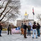 Armed protesters gather at heavily fortified state capitols of Ohio, Michigan, Texas and elsewhere