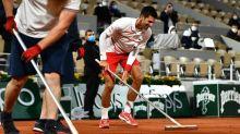 Novak Djokovic takes broom, sweeps French Open opponent