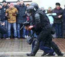 Hundreds detained as Belarus struggles to quell protests