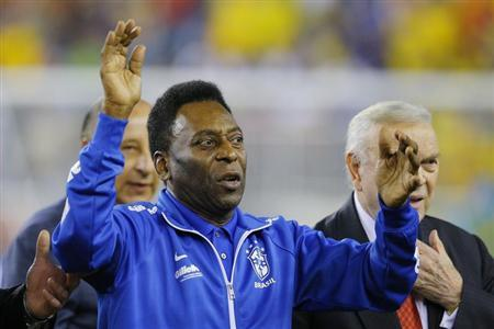 Soccer great Pele waves to the crowd before the international friendly soccer match between Brazil and Portugal in Foxborough