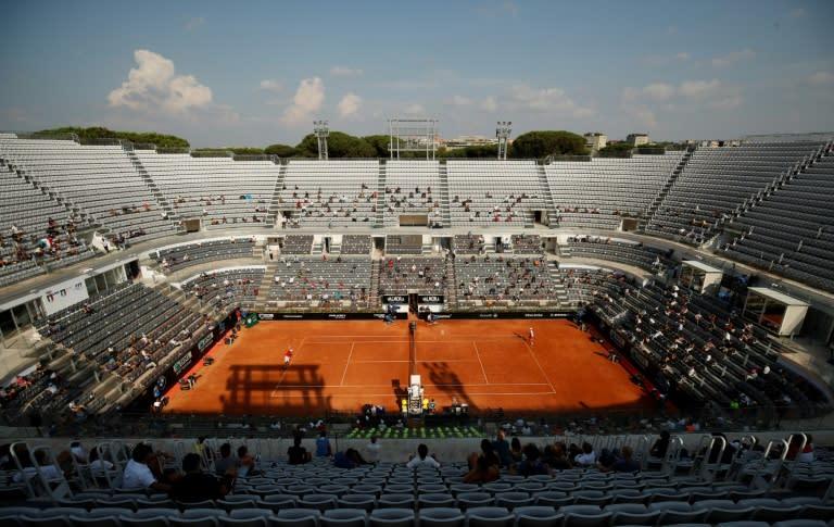 Socially-distanced fans watched Novak Djokovic (R) reach a 10th Rome final