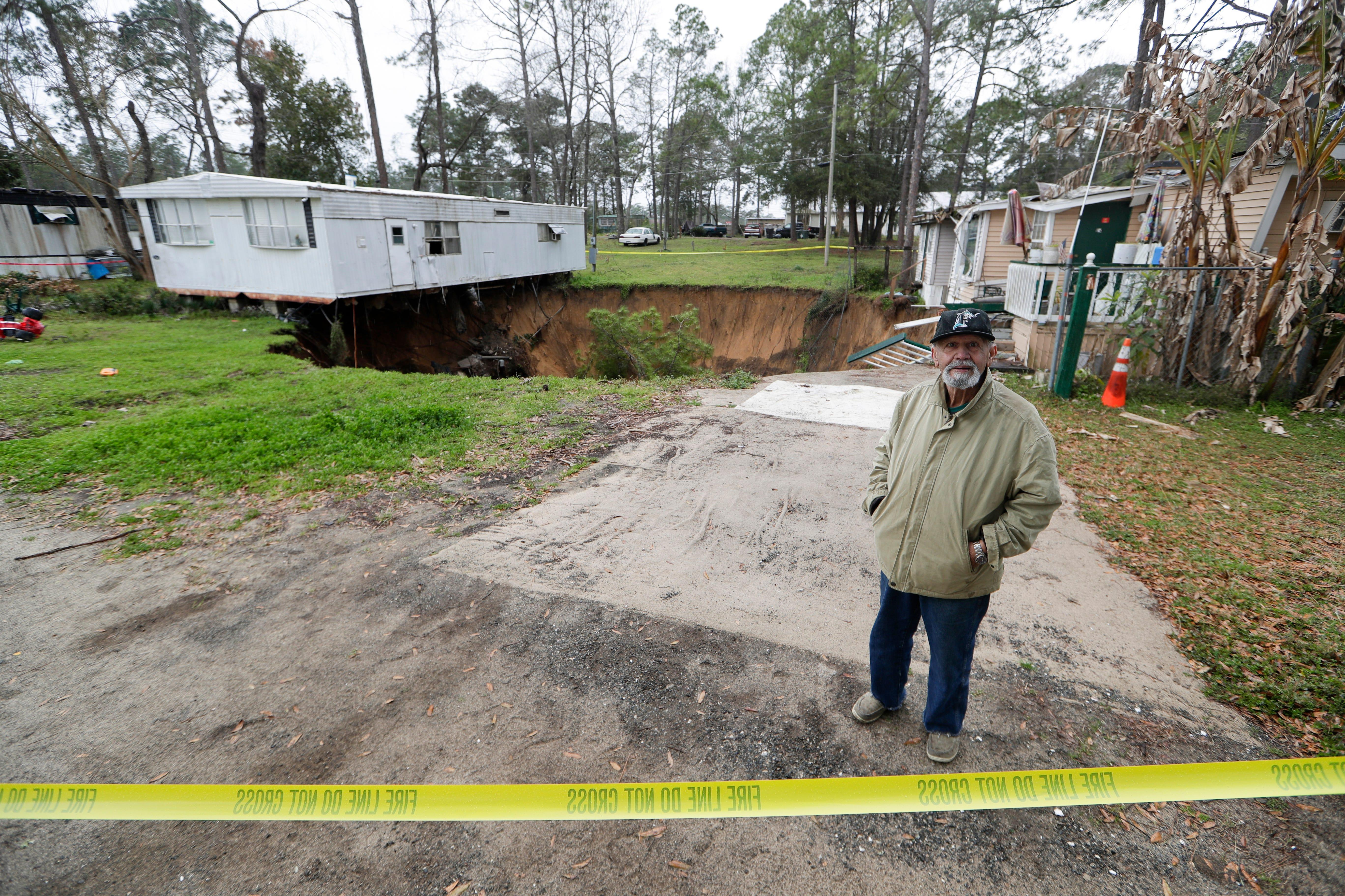 'Unbelievable': Giant sinkhole threatens to swallow two homes in Florida