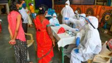 Patients share beds as coronavirus cases overwhelm Mumbai's hospitals