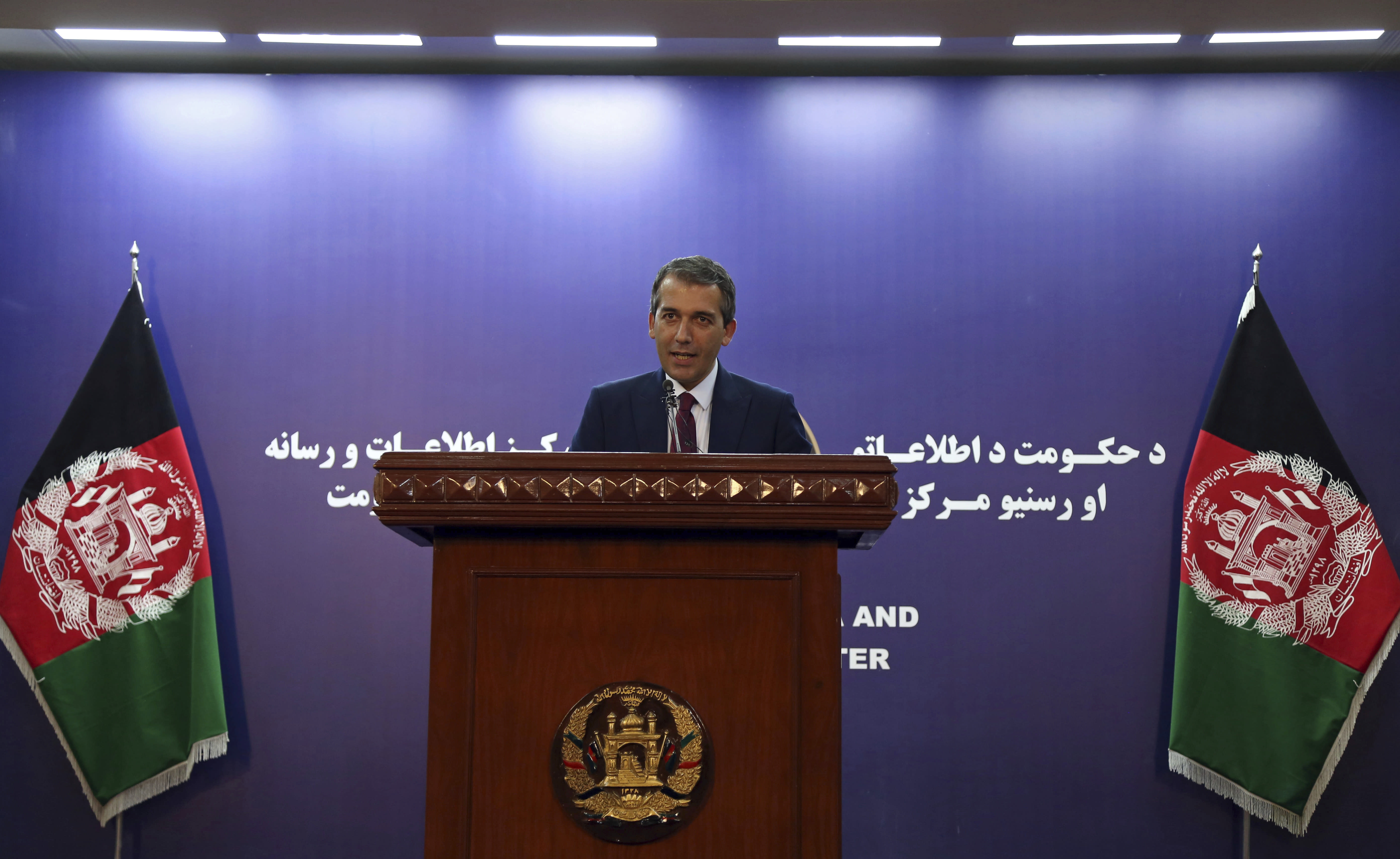 """Presidential spokesman Sediq Seddiqi speaks during a press conference in Kabul, Afghanistan, Monday, Sept. 2, 2019. A U.S. envoy showed the draft of a U.S.-Taliban agreement to Afghan leaders on Monday after declaring they were """"at the threshold"""" of a deal to end America's longest war, officials said. Seddiqi told reporters the Afghan government likely would take a """"couple of days"""" to study the deal. (AP Photo/Rahmat Gul)"""