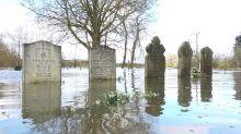 Graveyard under water as River Severn bursts banks in rural Worcestershire